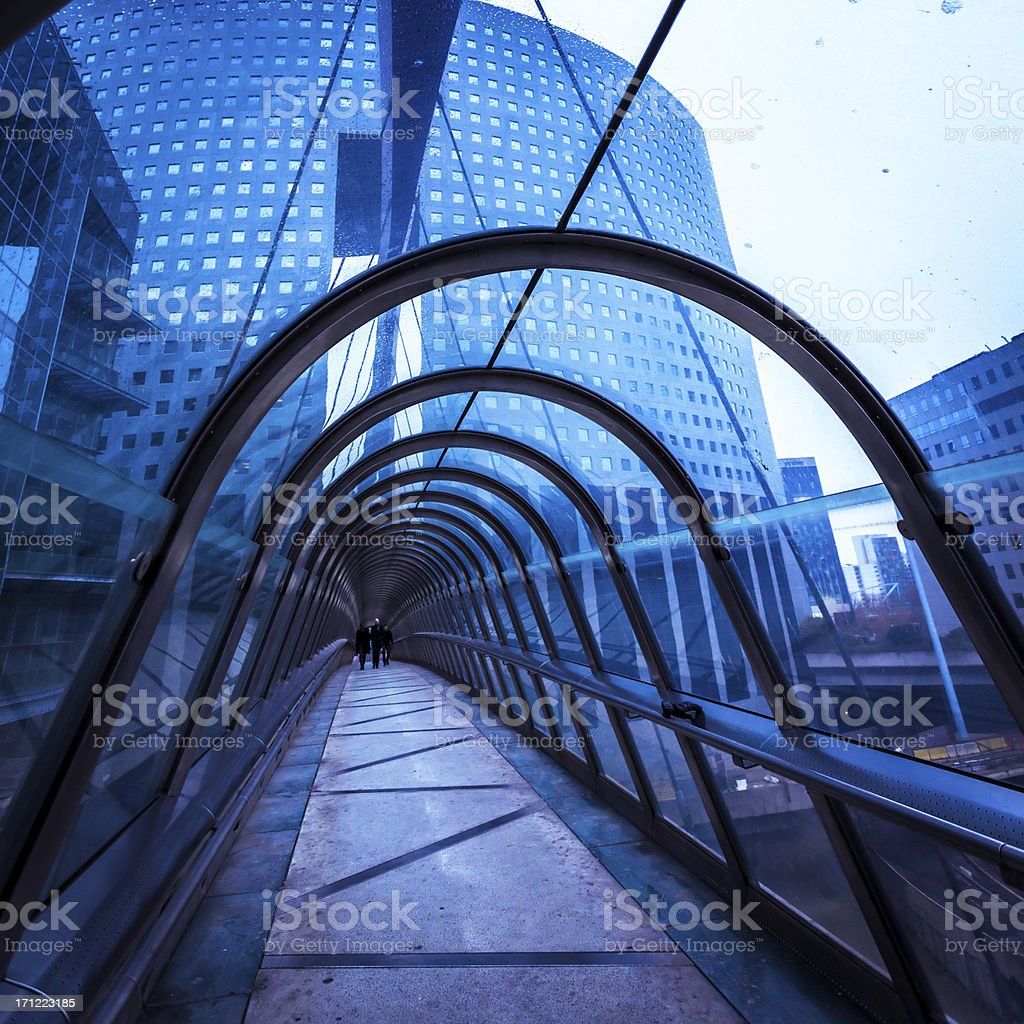 People Walking inside Futuristic Connection Tunnel royalty-free stock photo
