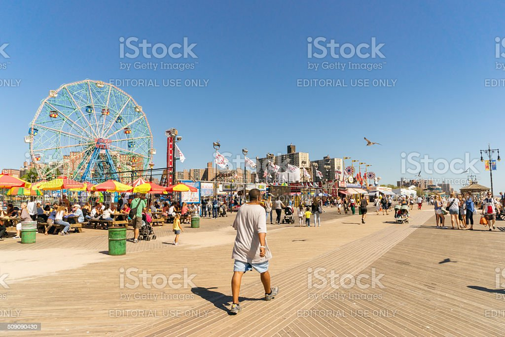 People walking long Riegelmann Boardwalk stock photo