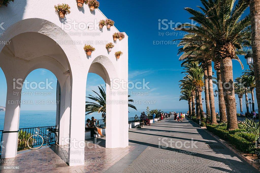 People walking near Balcon de Europa in Nerja, Spain stock photo