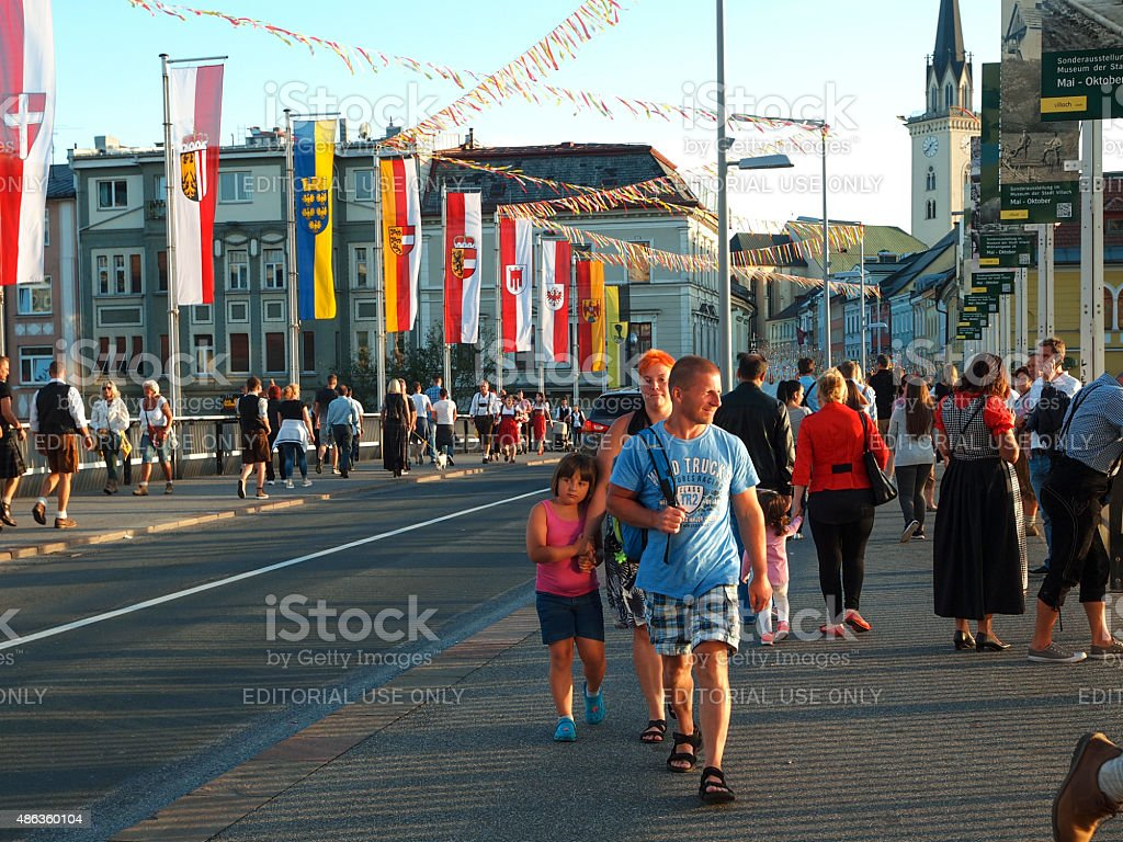 People walking near Villacher Kirchtag festival in Austria. stock photo