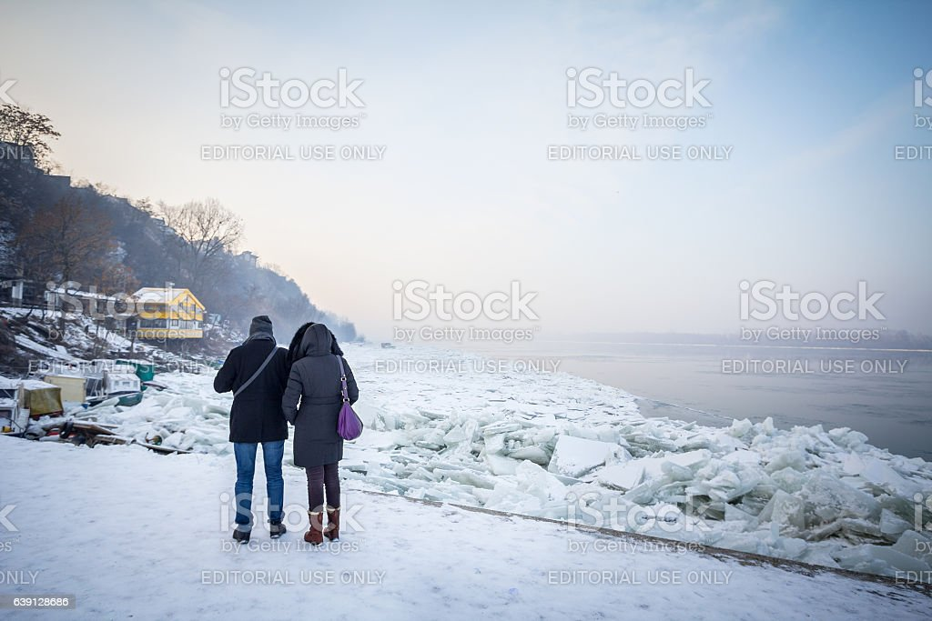 People walking next to the frozen Danube, in Belgrade, Serbia stock photo