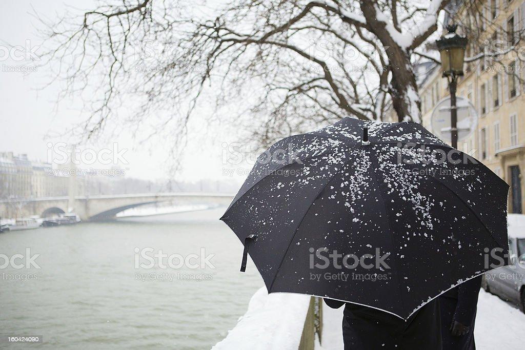 People walking on a Parisian street under snow royalty-free stock photo