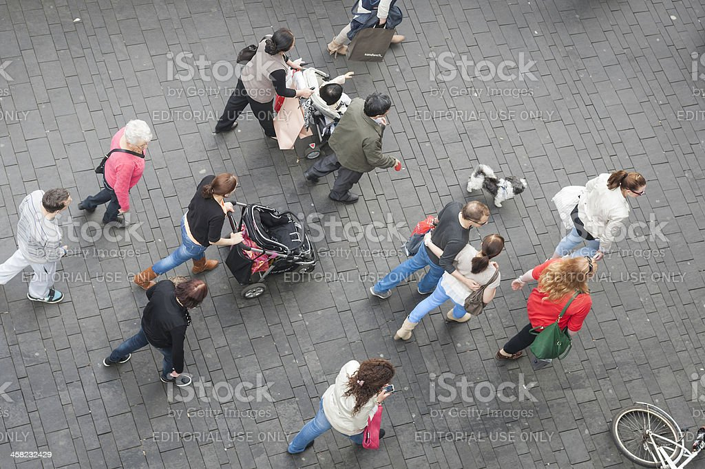 People walking on a square in Enschede stock photo