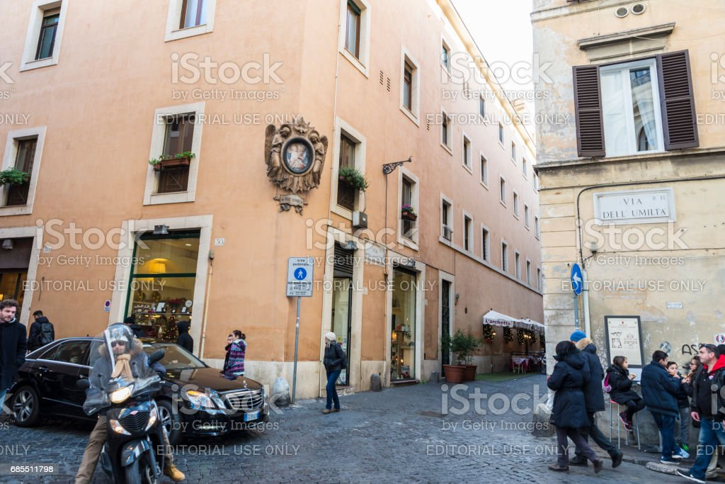 People walking on a street in Rome, Italy stock photo