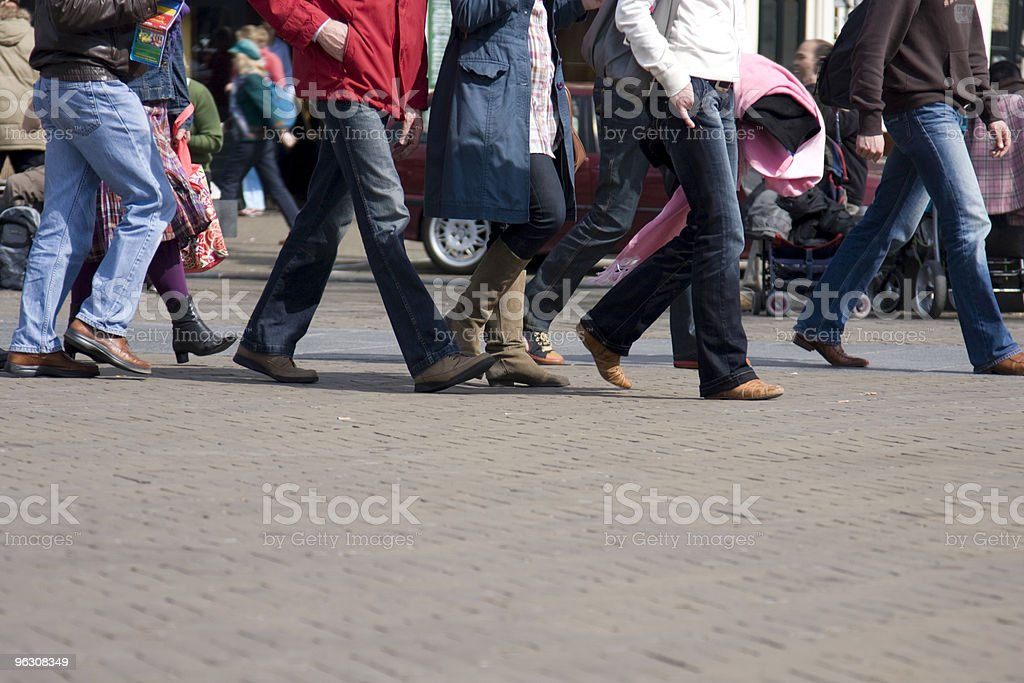 People walking on a street royalty-free stock photo