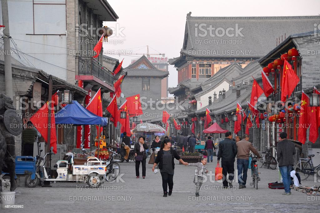 People walking on an old street in Hohhot, Inner Mongolia stock photo