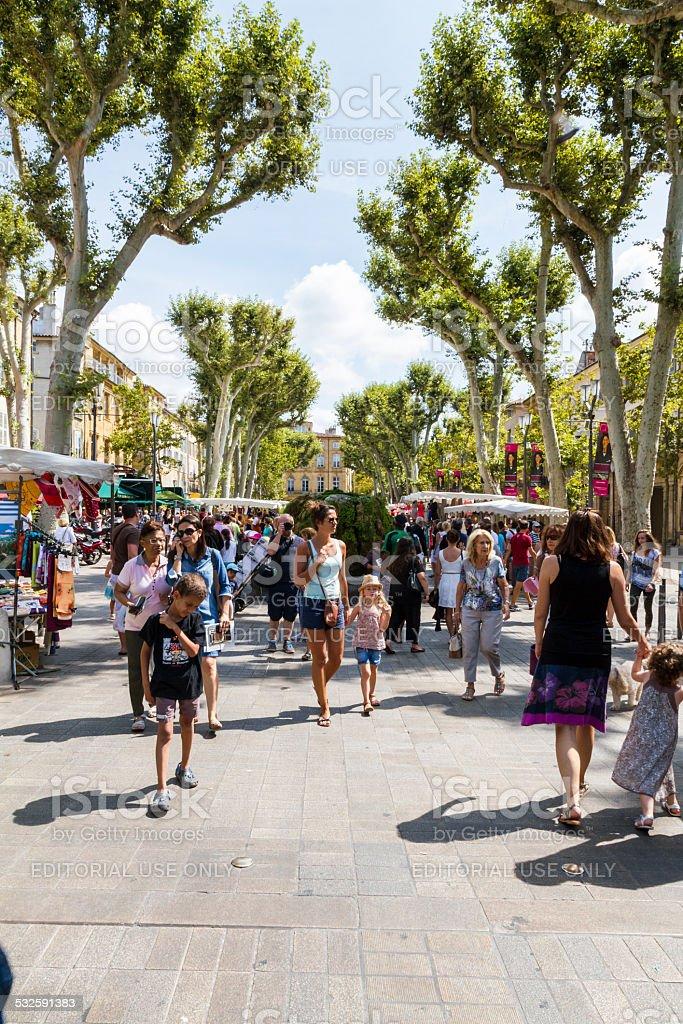 People walking on Cours Mirabeau stock photo