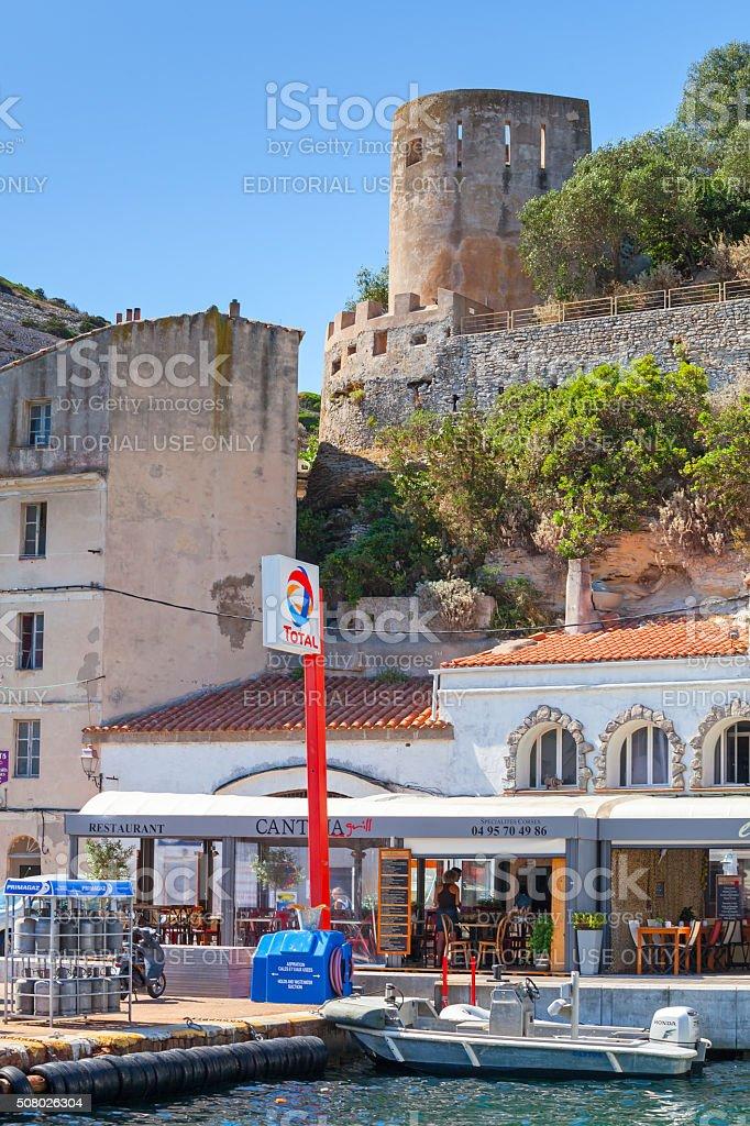 People walking on embankment of port town, Corsica stock photo