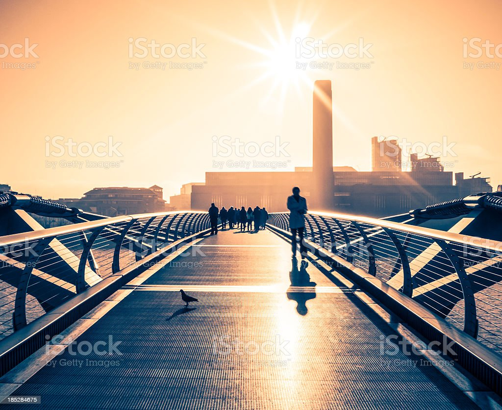 People Walking On Millenium Bridge, London stock photo