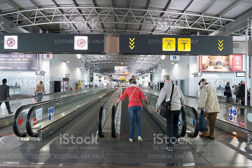 People walking on moving sidewalk in Brussels Airport,Belgium stock photo
