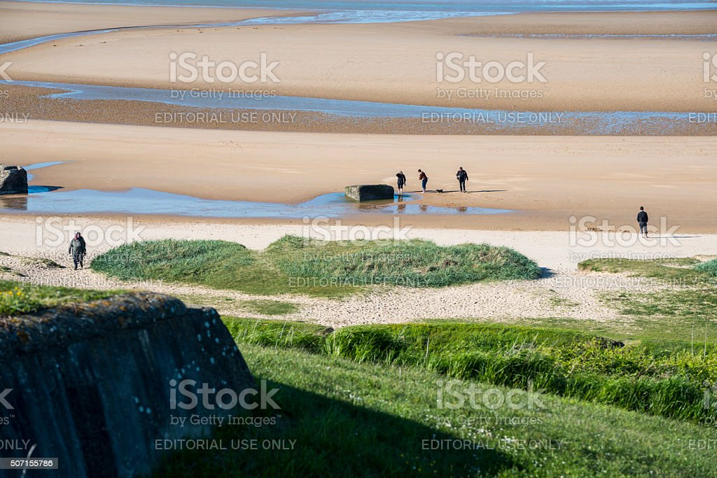 People walking on Omaha Beach, Normandy, France stock photo