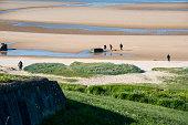 People walking on Omaha Beach, Normandy, France