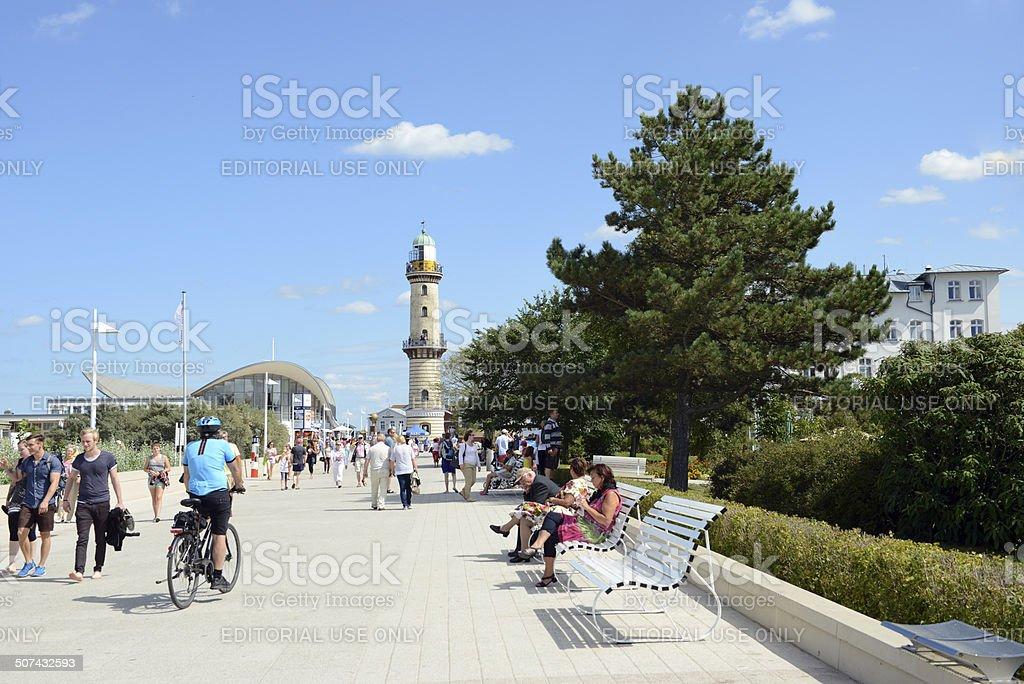 People walking on promenade of Warnem?nde at Baltic Sea royalty-free stock photo