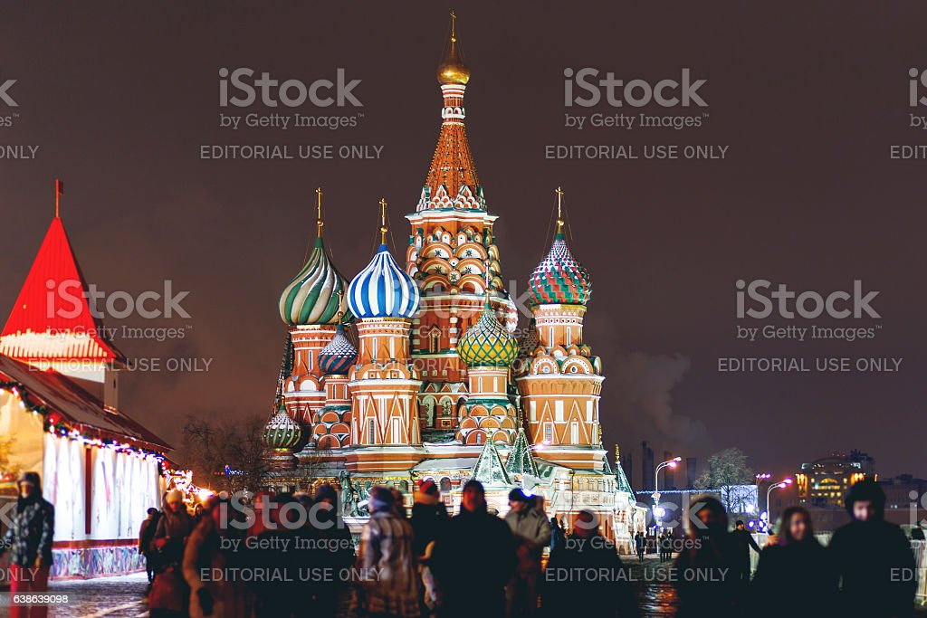 People walking on Red Square near St. Basil's Cathedral. Moscow. stock photo