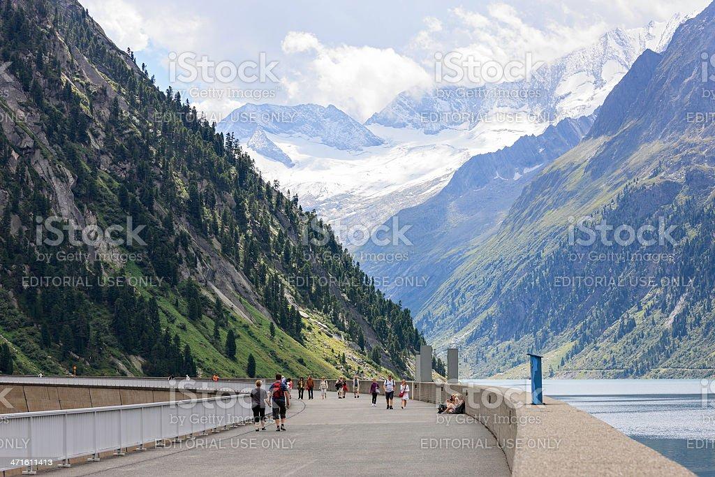 People walking on Schlegeis dam,Tirol, Austria in summer royalty-free stock photo