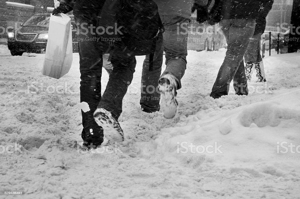 people walking on snow stock photo