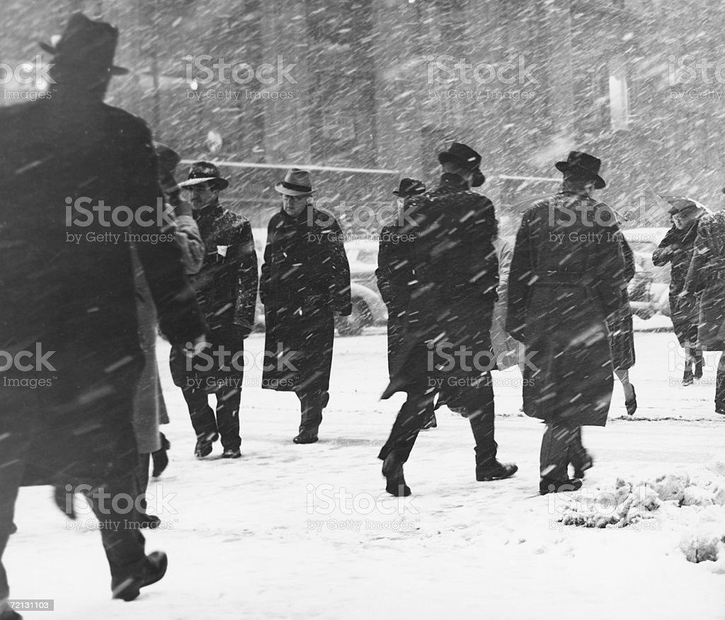 People walking on street in snowstorm royalty-free stock photo