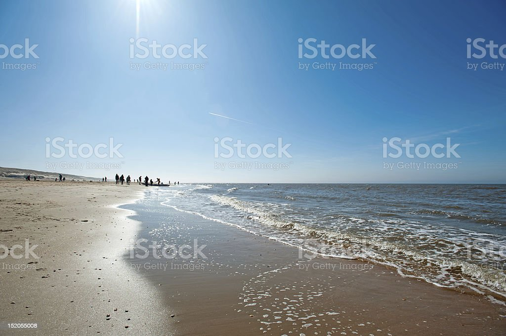 People walking on the beach in spring royalty-free stock photo