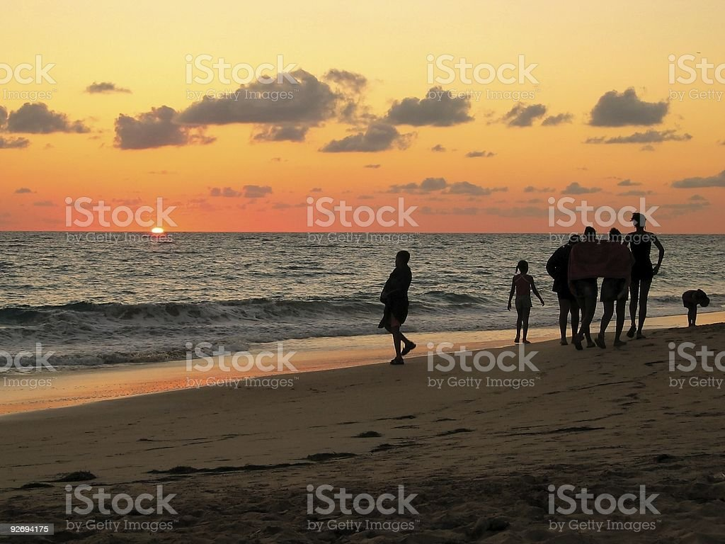 People walking on the beach royalty-free stock photo