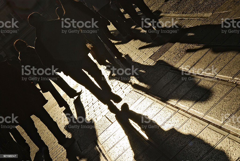 People walking on the city street royalty-free stock photo