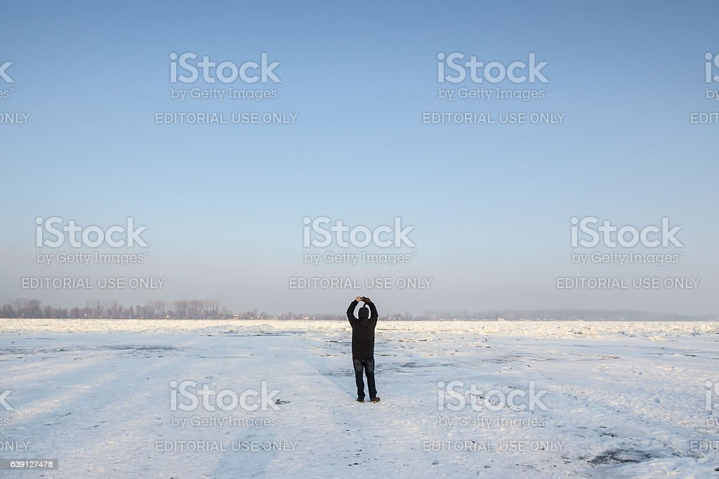 People walking on the frozen Danube in Belgrade, Serbia stock photo