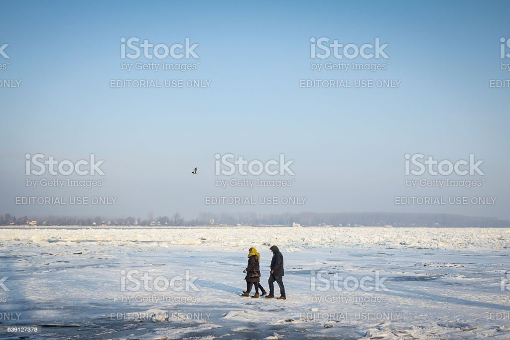People walking on the frozen Danube stock photo