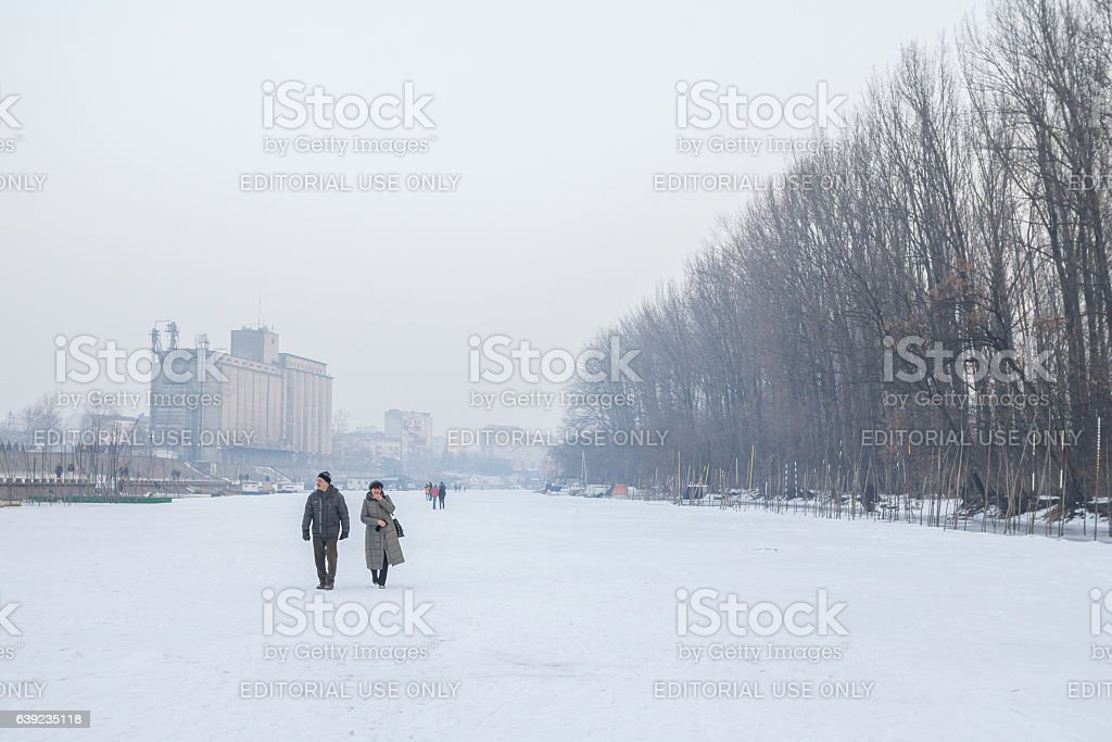 People walking on the frozen river Tamis (a Danube tributary) stock photo