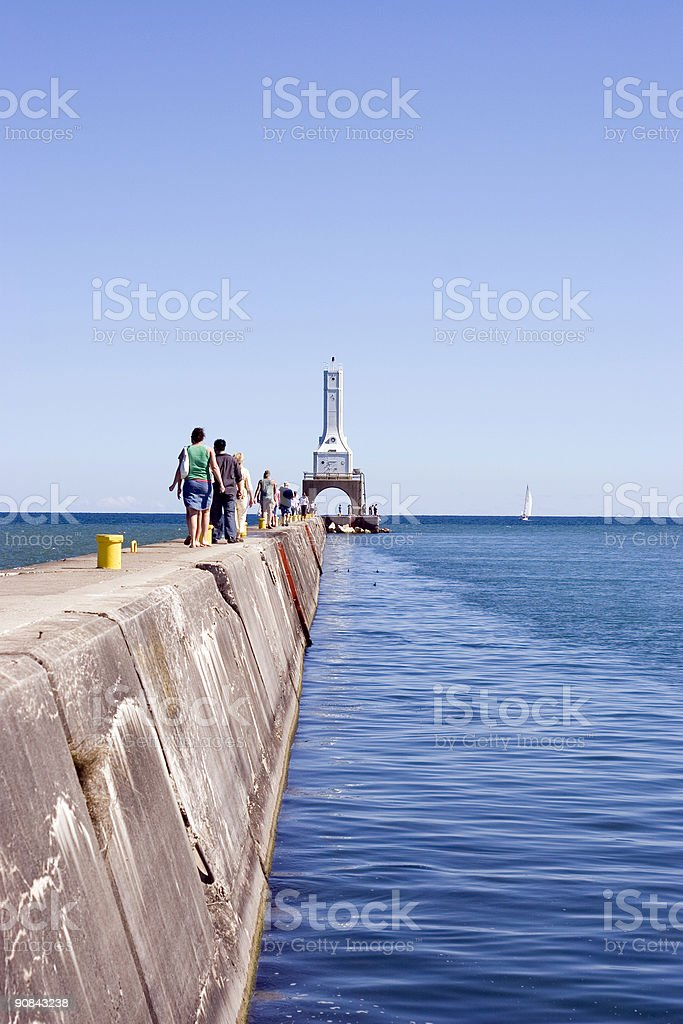 People walking on the Lighthouse Pier stock photo