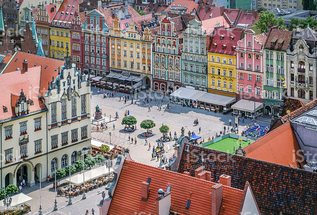 People walking on the market square in Wroclaw, Poland. stock photo