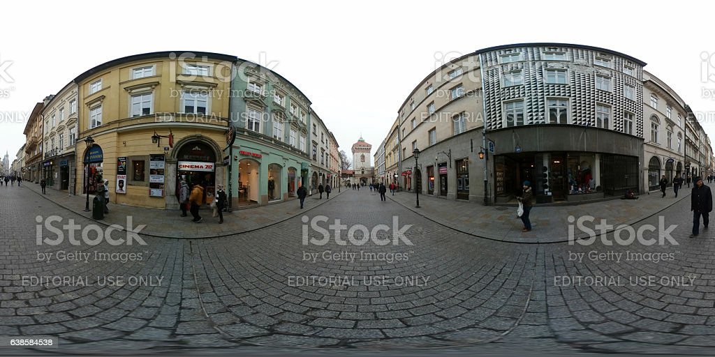 People walking on the street in old town, visiting shops stock photo
