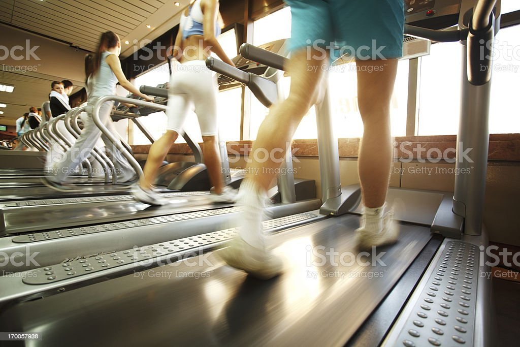 People walking on the treadmill in gym. royalty-free stock photo