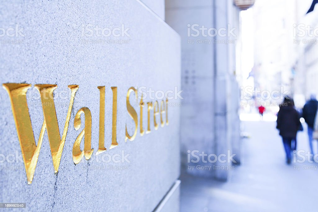 People Walking on the Wall Street stock photo