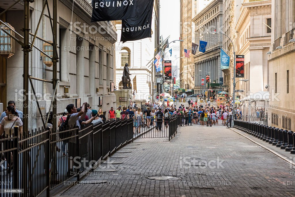 People walking on Wall Street stock photo