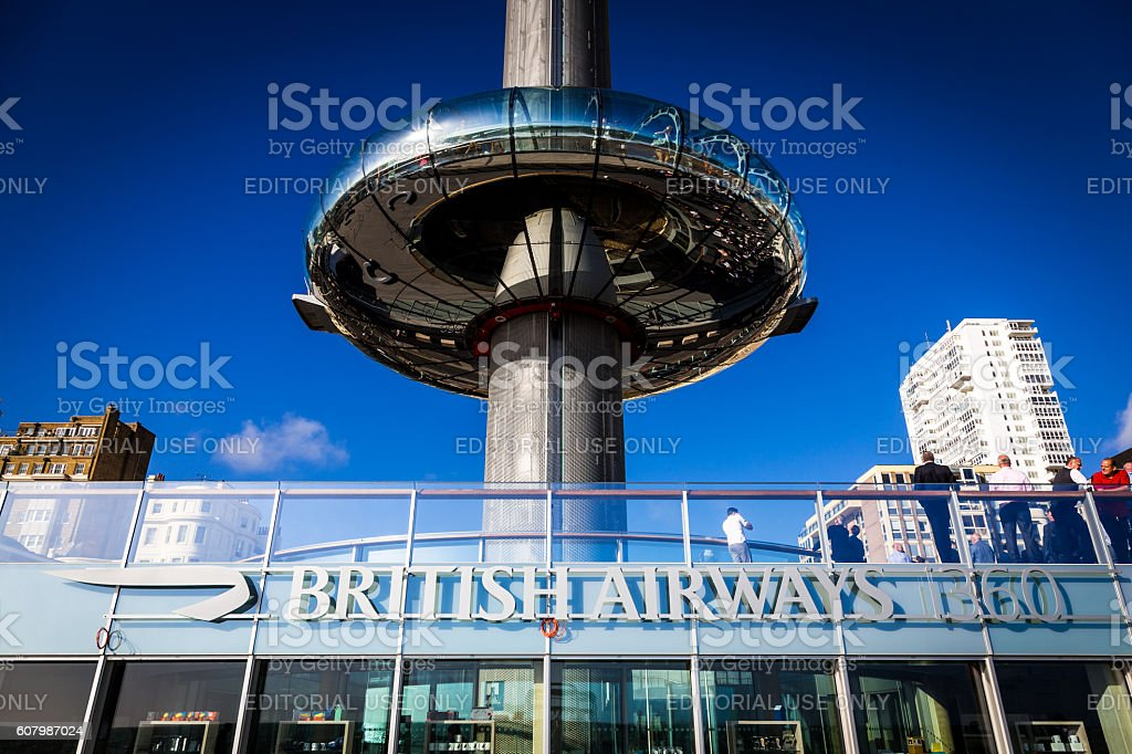 People walking outside British Airways i360 tower in Brighton, UK stock photo
