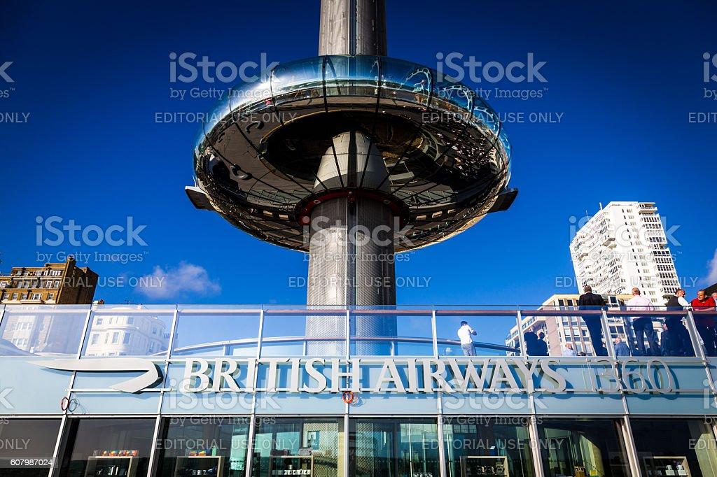 People walking outside British Airways i360 tower in Brighton, UK stock photo