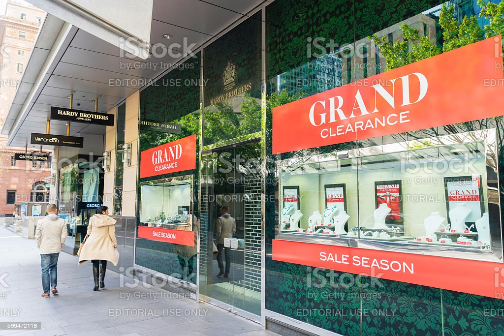 People walking pass a jewellery store in Sydney stock photo