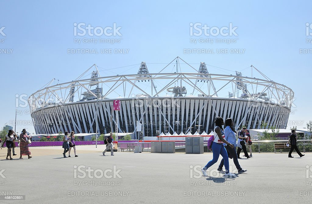 People Walking Past Olympic Stadium stock photo
