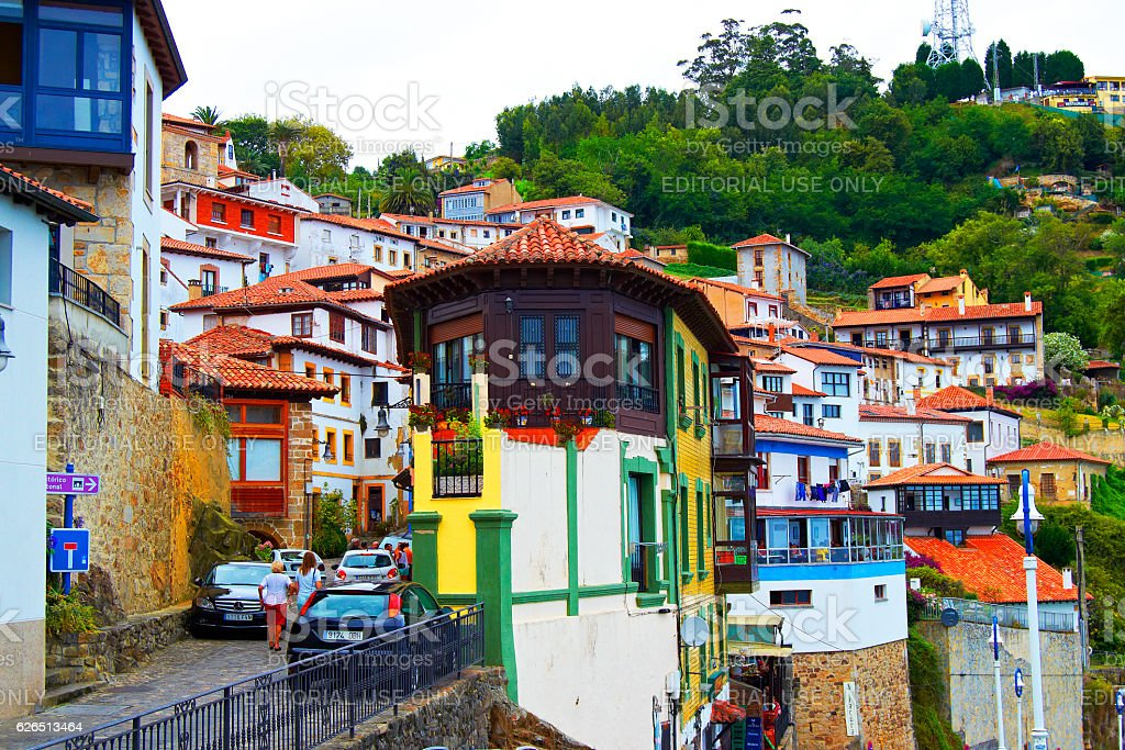 People walking the streets during the day Lastres, Spain stock photo