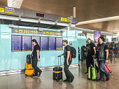 People walking through El Prat Airport, Barcelona