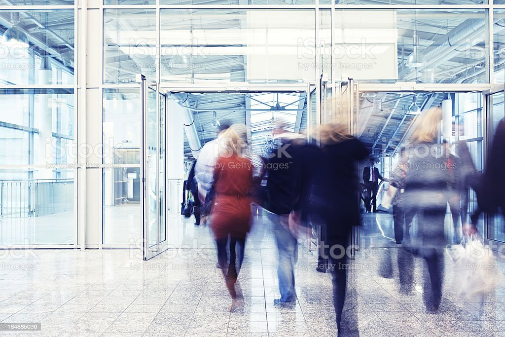 People Walking Through Entrance Door of Modern Building royalty-free stock photo