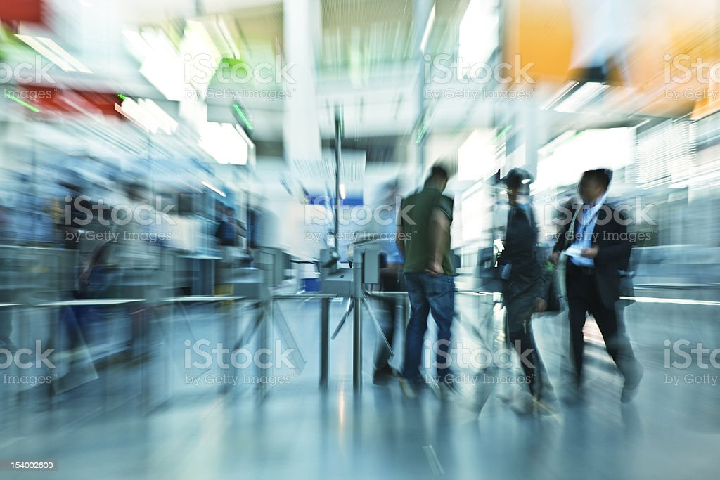 People Walking Through Ticket Gates, Zoom and Motion Blur stock photo