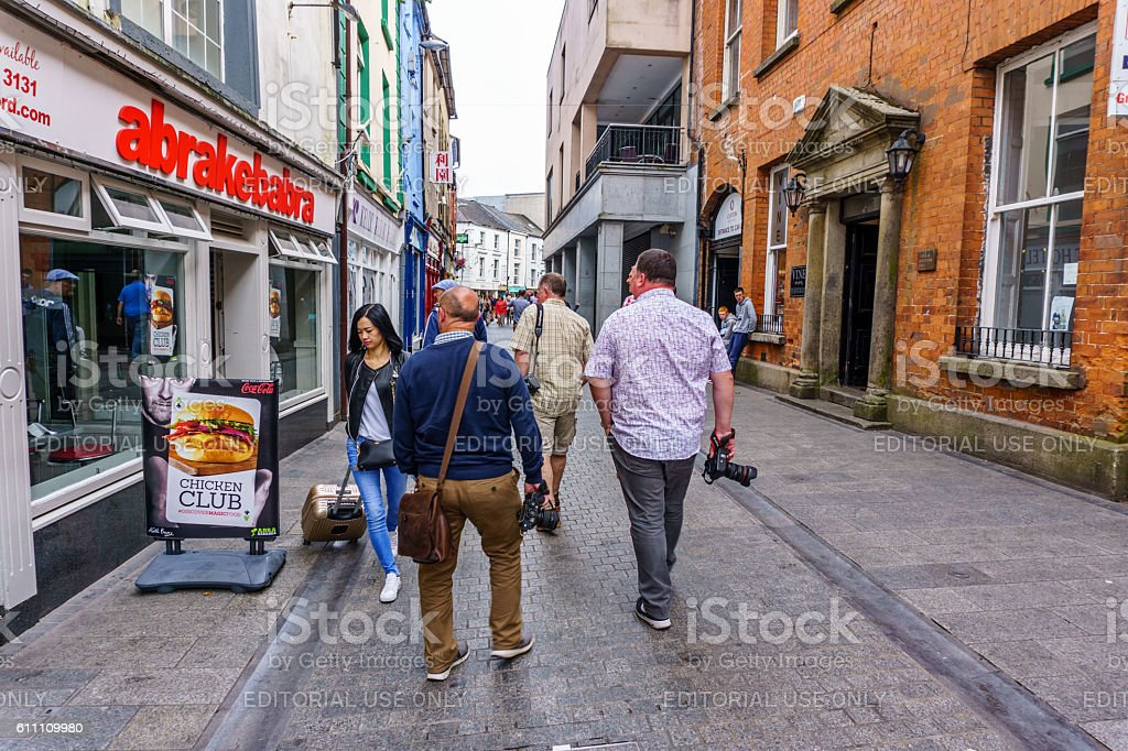 People walking through Wexford town centre stock photo