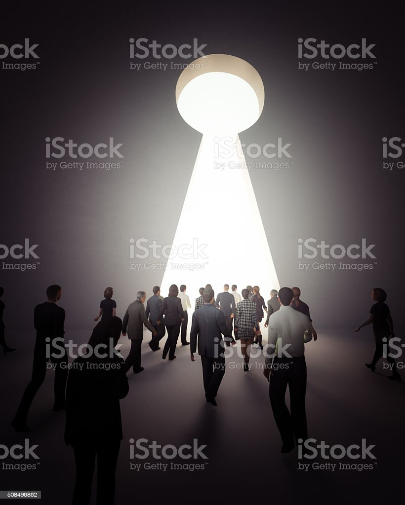 people walking to the light stock photo