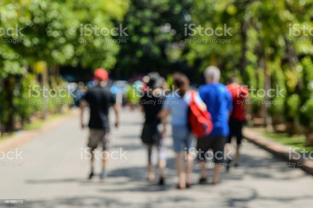 People walking tour,picture is blurred. stock photo