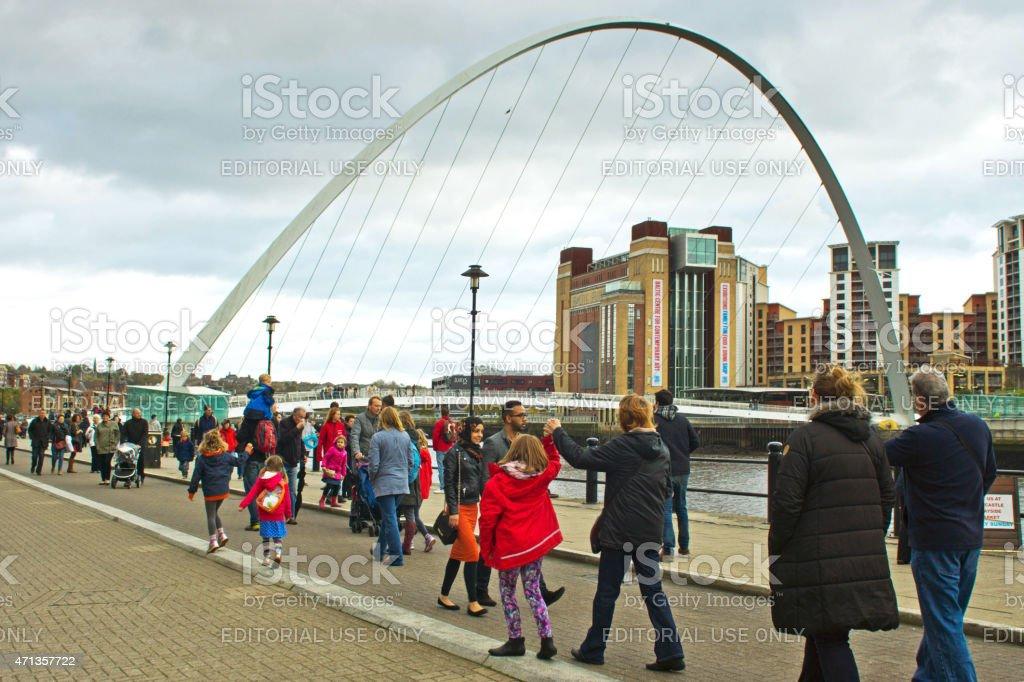 People walking towards the Millenium Bridge stock photo
