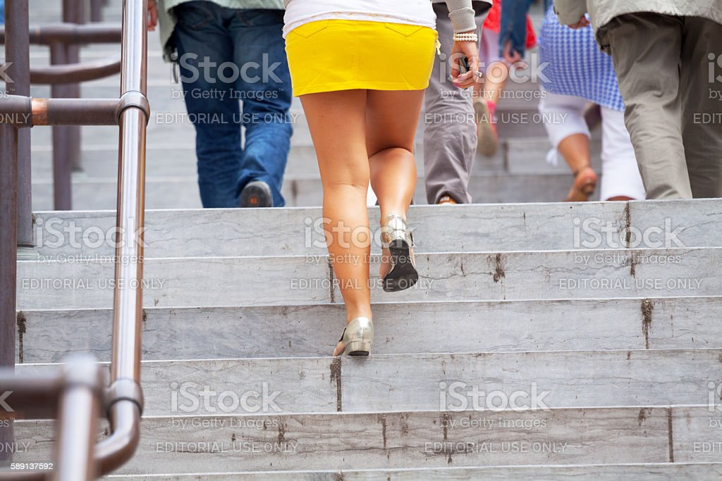 People walking upstairs at summertime stock photo