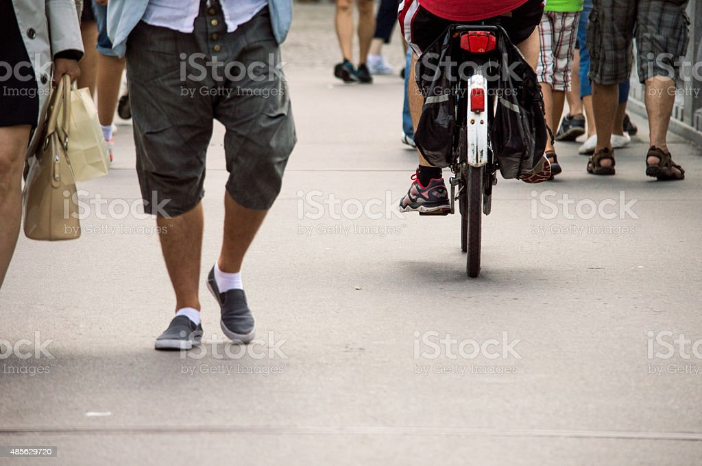 People Walking/Cycling on a Street Pavement royalty-free stock photo