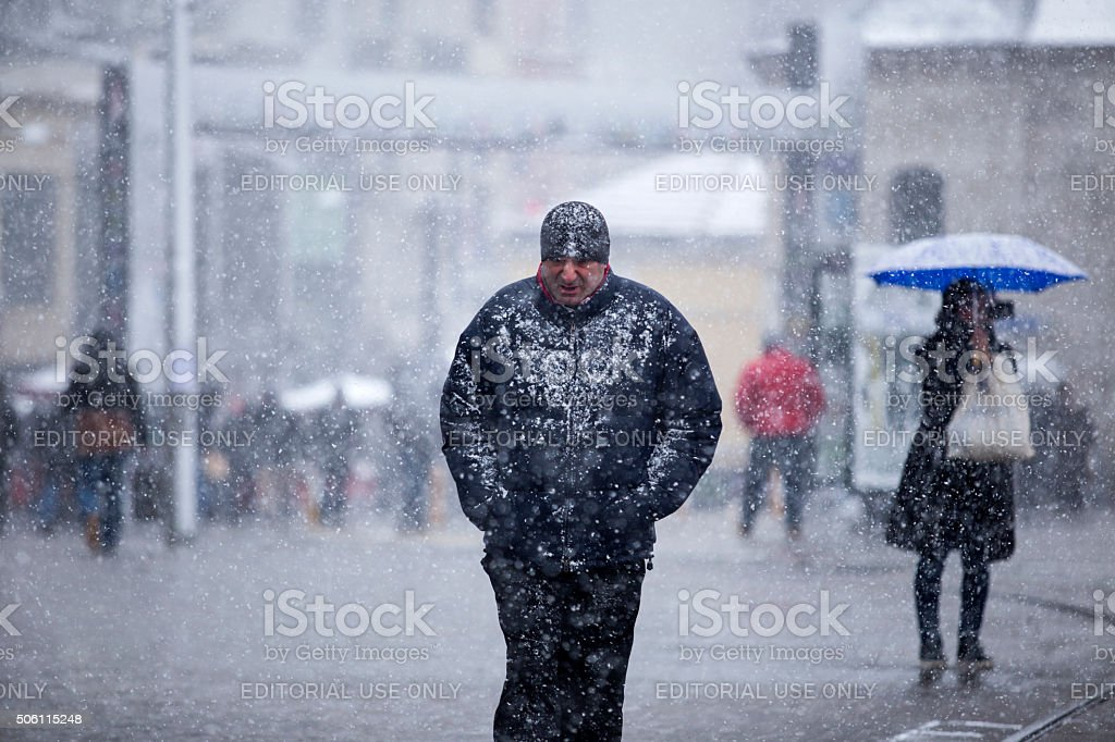 People walks in Istiklal Street under heavy snow in istanbul stock photo