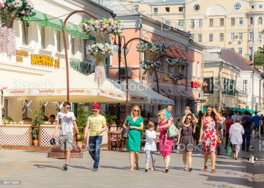 People wallking on Klimentovsky lane in Moscow stock photo