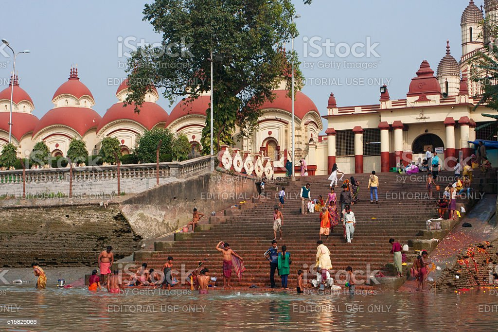 People wash in water of the ghat near Kali Temple stock photo